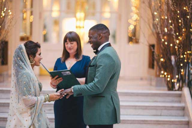 Photograph of a couple with Zena taking their vows in a Humanist wedding ceremony